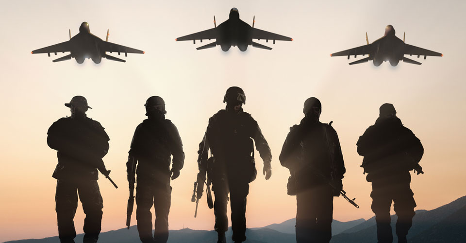 Armed Forces soliders with jets flying overhead